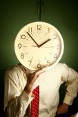 Man holding a clock to his face — Stock Photo