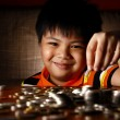 Young Boy Stacking or Piling Coins — Stock Photo #69984151