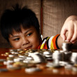 Young Boy Stacking or Piling Coins — Stock Photo #69984209