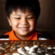 Young Boy Stacking or Piling Coins — Stock Photo #69984653