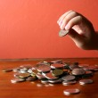 Hand picking a coin from a Bunch of loose change or coins — Stock Photo #71070263