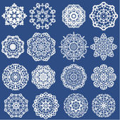 Set of Decorative paper snowflakes. White on blue background — Stock Vector