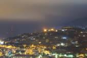 City under mountain at night — Stock Photo