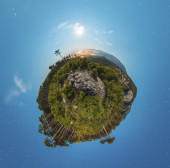 Little planet panorama at night with clouds and city light — Stockfoto