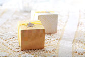 Hand-crafted gift boxes with star-shaped labels — Photo
