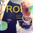 Businessman drawing ROI (return on investment) — Stock Photo #52559315