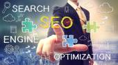 Businessman pointing SEO (search engine optimization) — Stock Photo