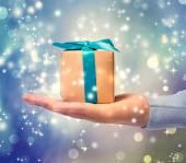 Present box on hand — Stock Photo