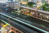 Trains and traffic at night — Stock Photo