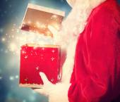 Santa Claus Opening Christmas Present — Stock Photo