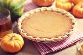Pumpkin pie with small pumpkins — Stock Photo