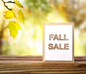 Fall Sale sign over yellow leaves background — Stock Photo