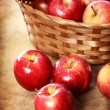 Red apples in a basket — Stock Photo #55908315