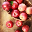 Red apples in a basket — Stock Photo #55908395