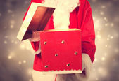 Santa Claus Holding and Opening a Big Christmas Present — Stock Photo