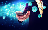 Bitcoin currency with smart phone — Stock Photo