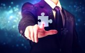 Piece of puzzle with businessman — Photo