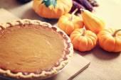 Pumpkin pie with autumn vegetables — Stock Photo