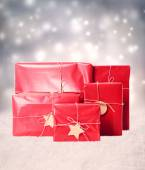Gift boxes in snowing night — Stock Photo
