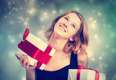 Happy young woman holding present boxes — Stok fotoğraf