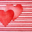 Two handcrafted paper hearts on striped background — Stock Photo #57857517
