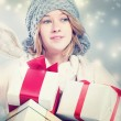 Happy young woman holding many gift boxes — Stock Photo #57857553