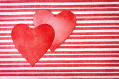 Two handcrafted paper hearts on striped background — Stock Photo
