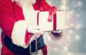 Santa Claus Giving a Christmas Present — Foto Stock