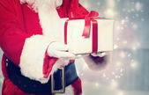 Santa Claus Giving a Christmas Present — Stock Photo