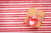 Little gift box with heart shaped tag — Stok fotoğraf