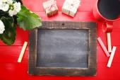 Blank chalkboard on red table — Stok fotoğraf