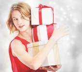 Happy woman holding a many present boxes — ストック写真