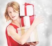 Happy woman holding a many present boxes — Stock Photo
