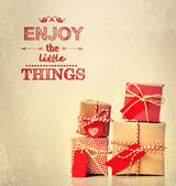 Enjoy the Little Things text with gift boxes — Stock Photo