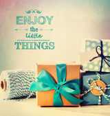 Enjoy the little things with blue handmade gift boxes — Stock Photo