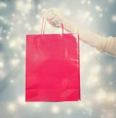 Girl holding a big red shopping bag — ストック写真