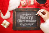Merry Christmas text with black chalkboard — Stock fotografie
