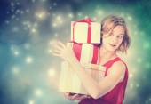 Happy woman holding a many present boxes — Fotografia Stock