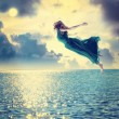 Girl jumping into sky — Stock Photo #60405067