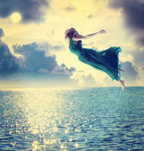 Girl jumping into sky — Stock Photo