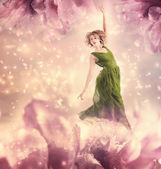 Beautiful woman in a green dress — Stock Photo