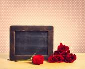 Empty rustic chalkboard with roses — Stock Photo