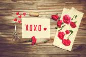 Gift card with carnation flowers — Stock Photo