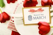 Womans day message card and tulips — Stock Photo