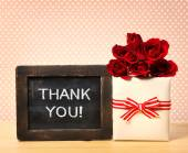 Thank you message on chalkboard with roses and present box — Stock Photo