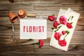 Florist theme with flowerpots, scissors, and carnation flowers — Stock Photo