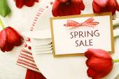 Dinner table setting with Spring Sale message — Stock Photo