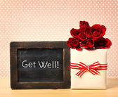 Get Well message with roses and present box — Stockfoto