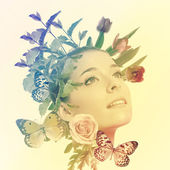 Woman with flowers and butterflies — Stock Photo
