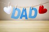DAD text and felt hearts hanging on a string — Stock Photo